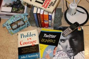 pring books on desk showing affection for print versus kindle reading