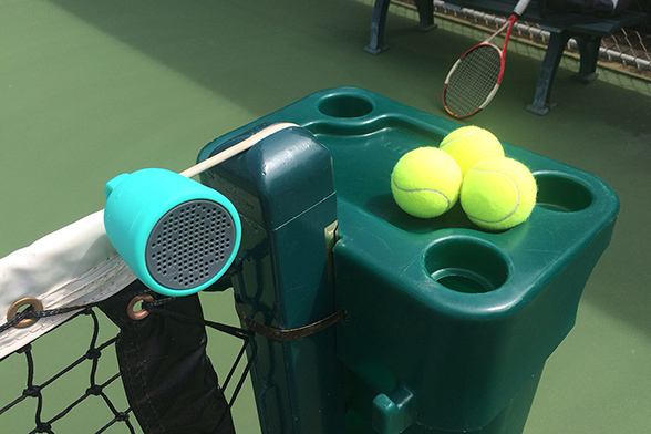 Boom Swimmer Speaker on a Tennis Court, photo by Ray Gordon