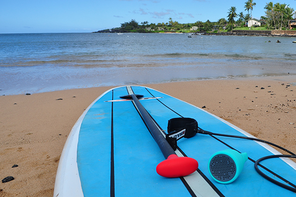 Boom Swimmer speaker on a Paddleboard. Photo by Ray Gordon
