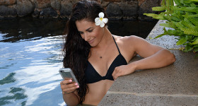Ashley Guarrasi in pool with LifeProof case photo by Ray Gordon