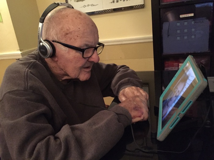 iPad for Elderly FaceTime with headphones